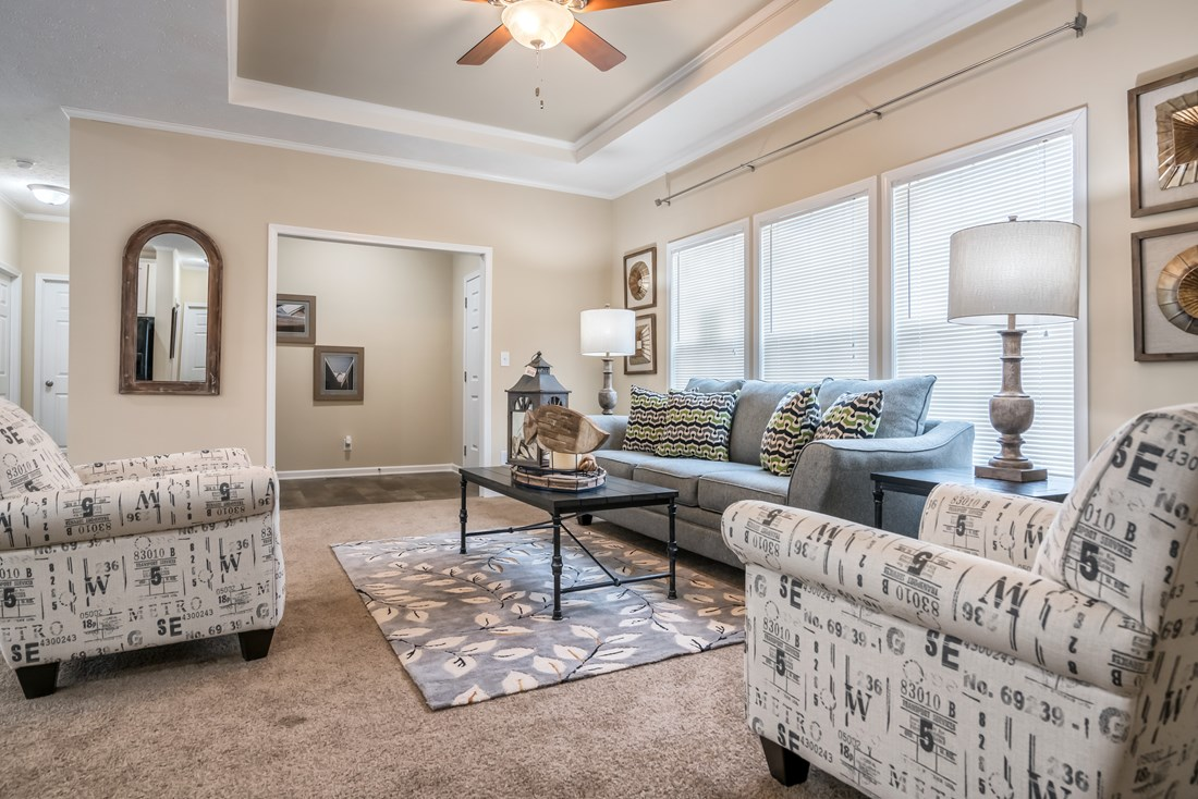 The 2088 HERITAGE Living Room. This Manufactured Mobile Home features 3 bedrooms and 2 baths.