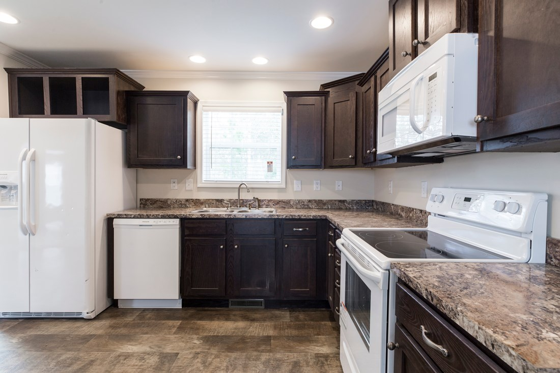 The 2089 52X28 3+2 HERITAGE Kitchen. This Manufactured Mobile Home features 3 bedrooms and 2 baths.