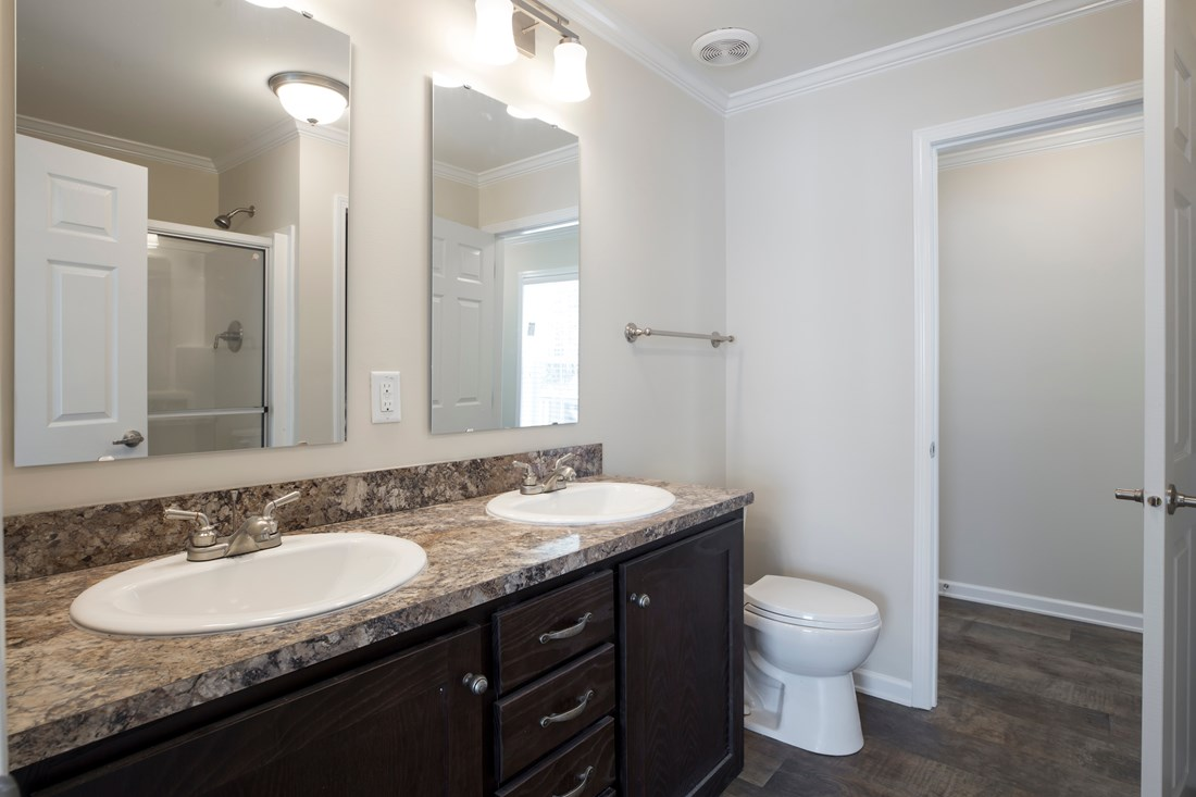 The 2089 52X28 3+2 HERITAGE Master Bathroom. This Manufactured Mobile Home features 3 bedrooms and 2 baths.
