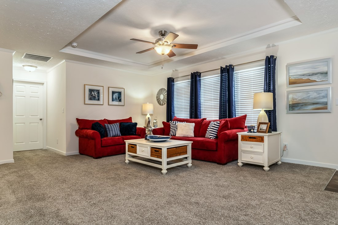 The 2467 HERITAGE Living Room. This Modular Home features 3 bedrooms and 2 baths.