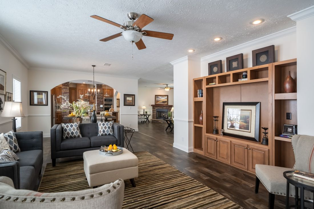 The 2097 HERITAGE Living Room. This Manufactured Mobile Home features 4 bedrooms and 2 baths.