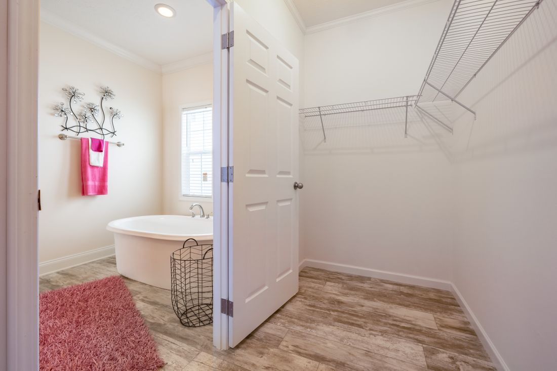 The 2097 HERITAGE Master Bathroom. This Manufactured Mobile Home features 4 bedrooms and 2 baths.
