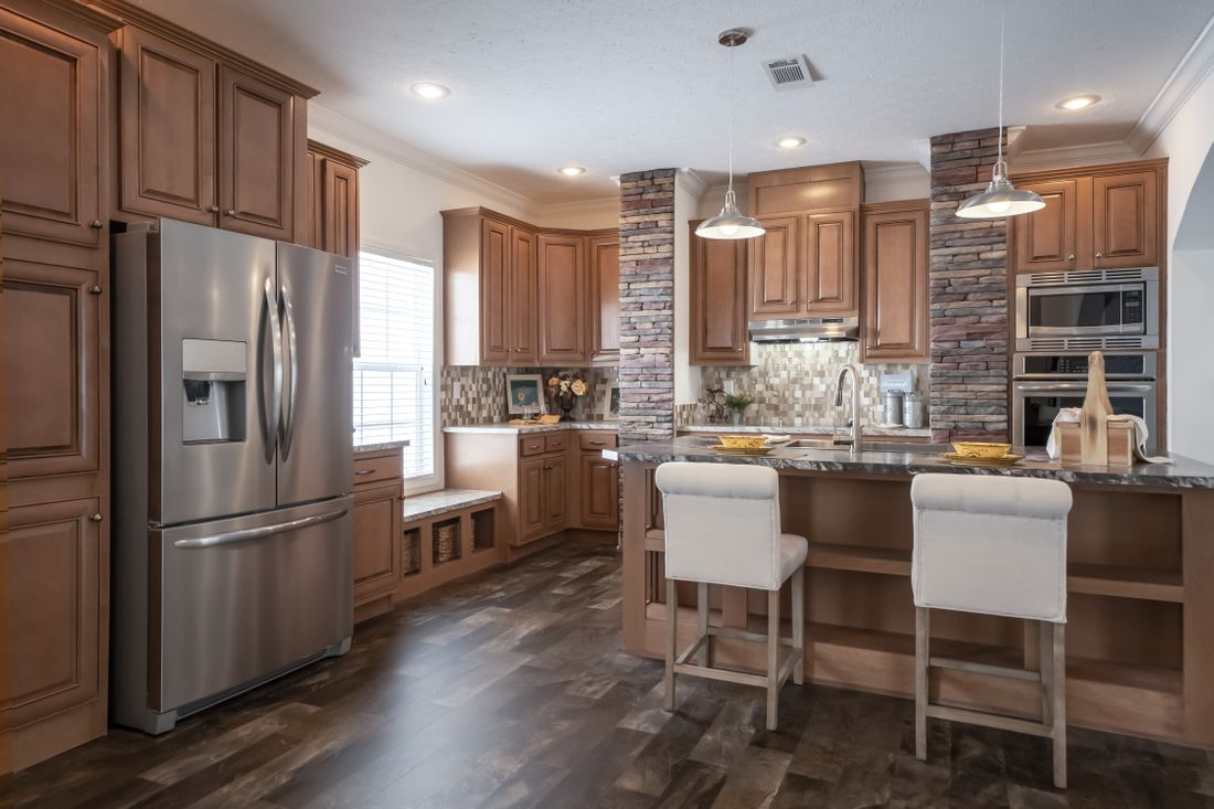 The 2097 HERITAGE Kitchen. This Manufactured Mobile Home features 4 bedrooms and 2 baths.