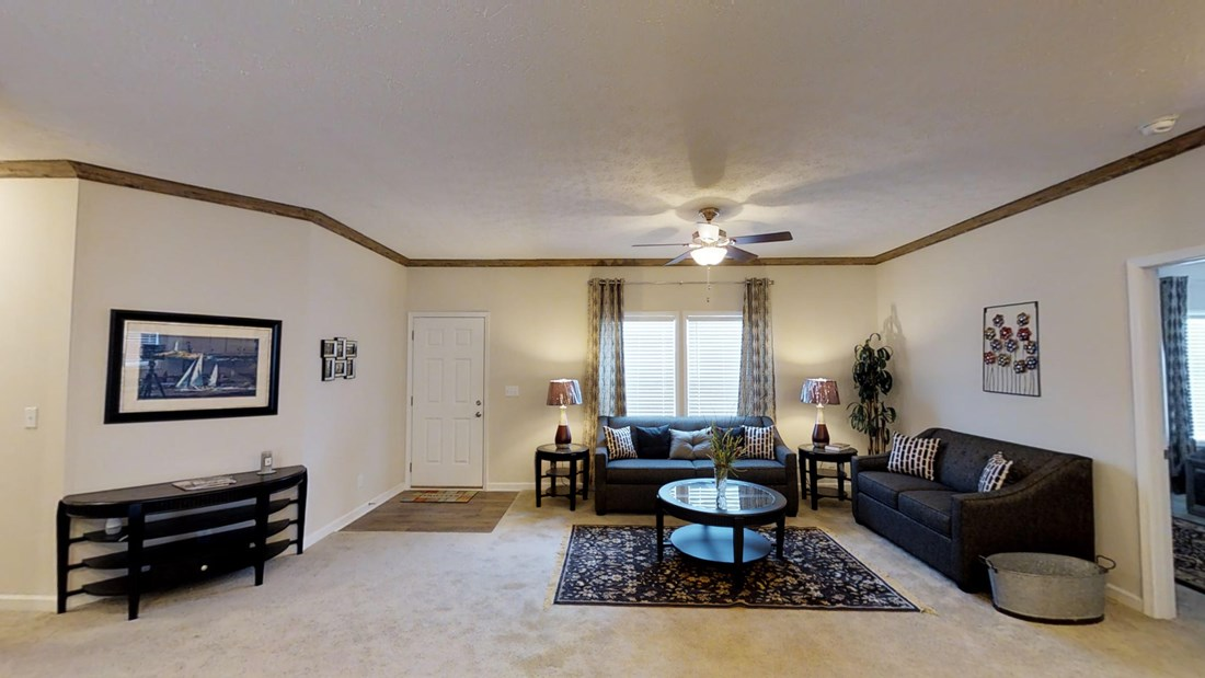 The 2917 HERITAGE Living Room. This Manufactured Mobile Home features 4 bedrooms and 2 baths.