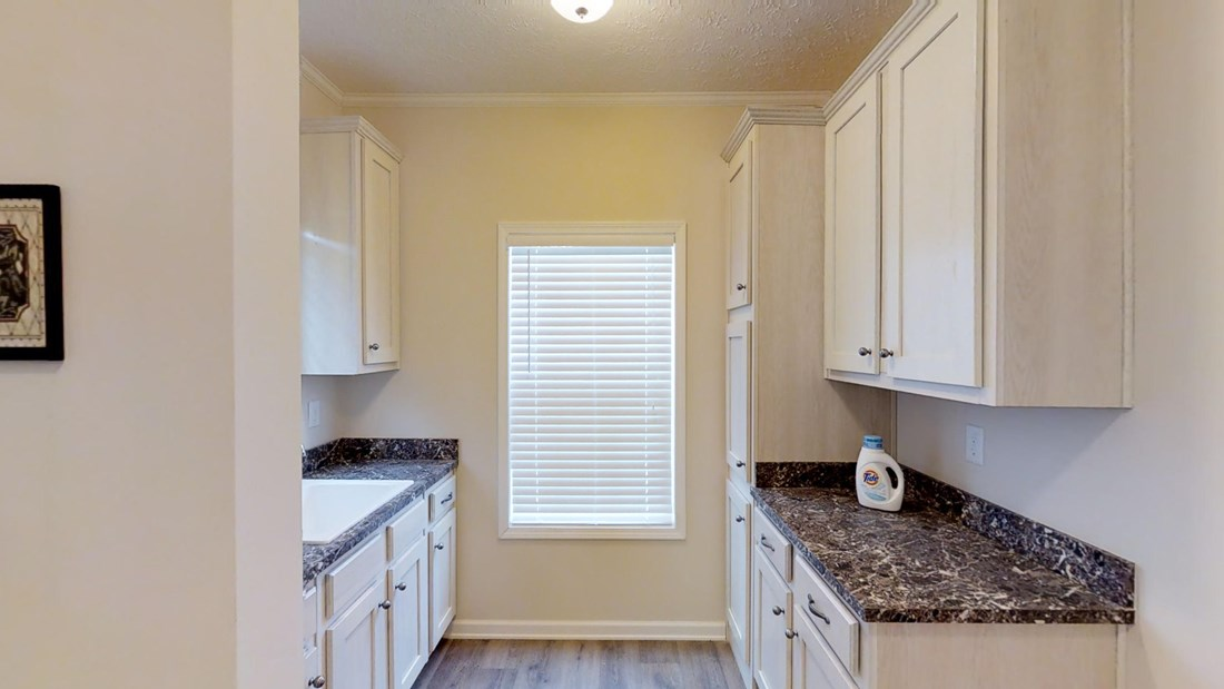 The 2917 HERITAGE Utility Room. This Manufactured Mobile Home features 4 bedrooms and 2 baths.