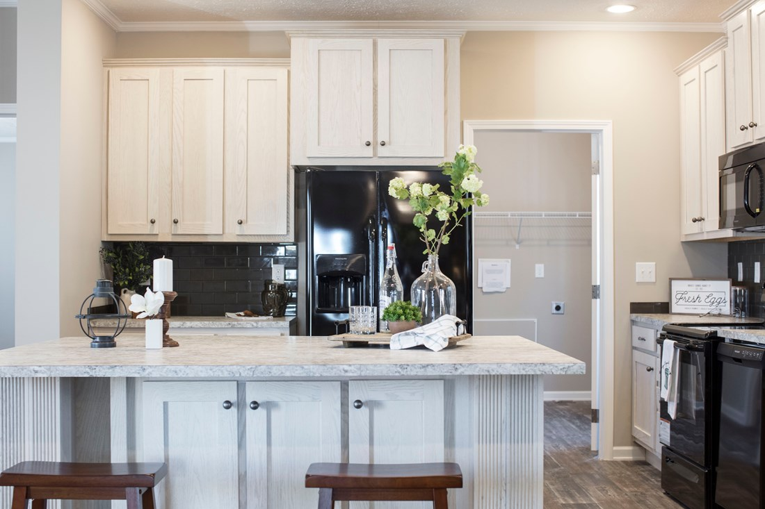 The 3338 HERITAGE Kitchen. This Manufactured Mobile Home features 4 bedrooms and 2 baths.