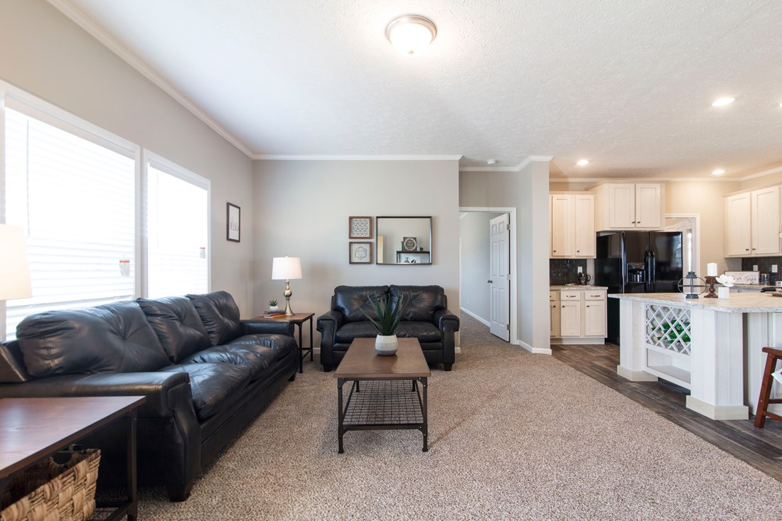 The 3338 HERITAGE Living Room. This Manufactured Mobile Home features 4 bedrooms and 2 baths.
