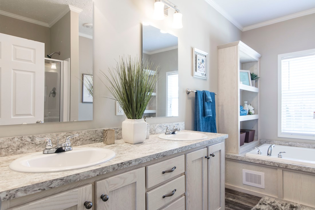 The 3338 HERITAGE Master Bathroom. This Manufactured Mobile Home features 4 bedrooms and 2 baths.